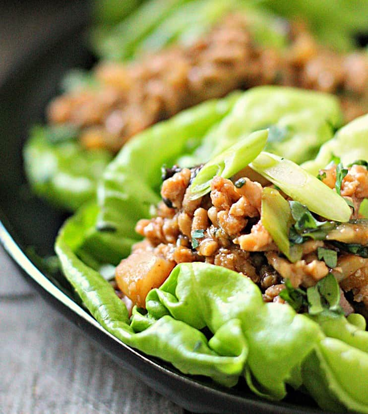 black plate with chicken lettuce wraps