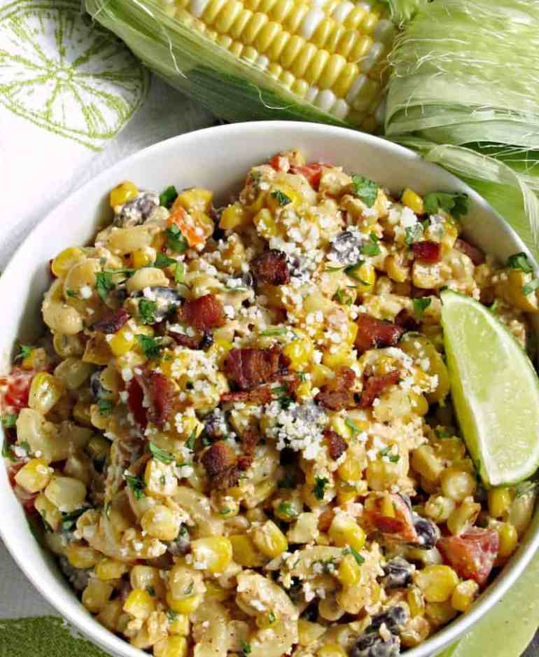 Mexican Street Corn Pasta Salad - charred sweet corn, pasta, peppers, tomatoes, black beans + bacon and a delicious creamy, tangy, slightly spicy dressing.
