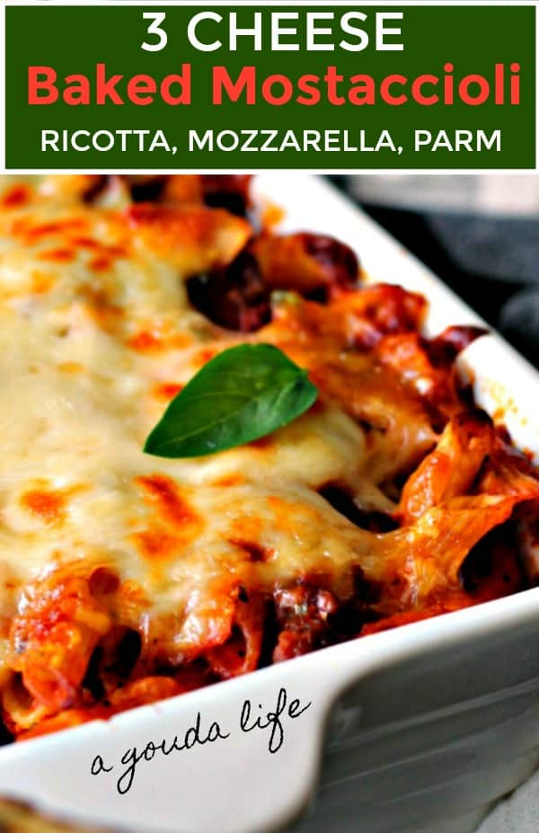 baked mostaccioli in white casserole dish topped with melted cheese