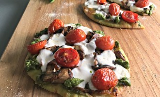 Wild Mushroom Pizza recipe. Naan crust topped with pesto, wild mushrooms, tomatoes and fresh mozzarella. Easy, delicious any night meal.