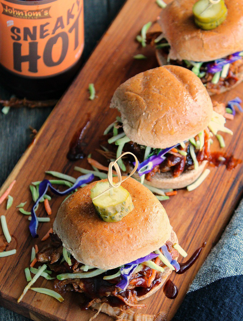 slow cooker beer braised pulled pork ~ 3 sliders with confetti slaw shown with JohnTom's BBQ Sauce.