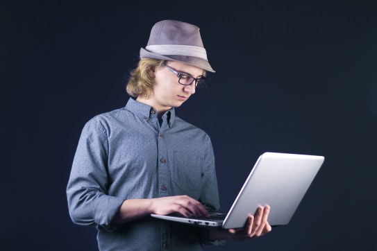a person holding a laptop