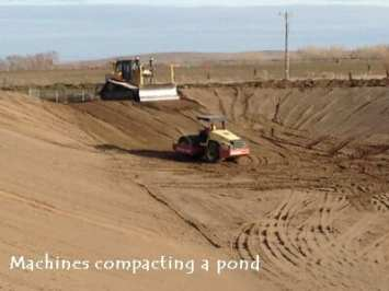 Machines working in a large pond