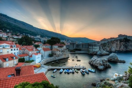 Harbour with boats and city walls of old town of Dubrovnik, Croatia.