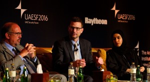 Michael Daly of Raytheon (left), Dr. Ernesto Damiani of Khalifa University, and Eman Al Awadhi discuss workplace preparedness against cyber attacks at the UAE Security Forum on  February 21 in Abu Dhabi.