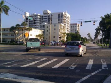 Crossing Southern Blvd, you often meet people going to work on Palm Beach Island