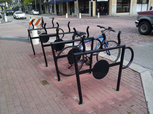 Bike racks outside Starbucks, dedicated to Mike Tague