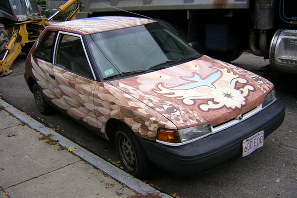 Car painted as a brown bird