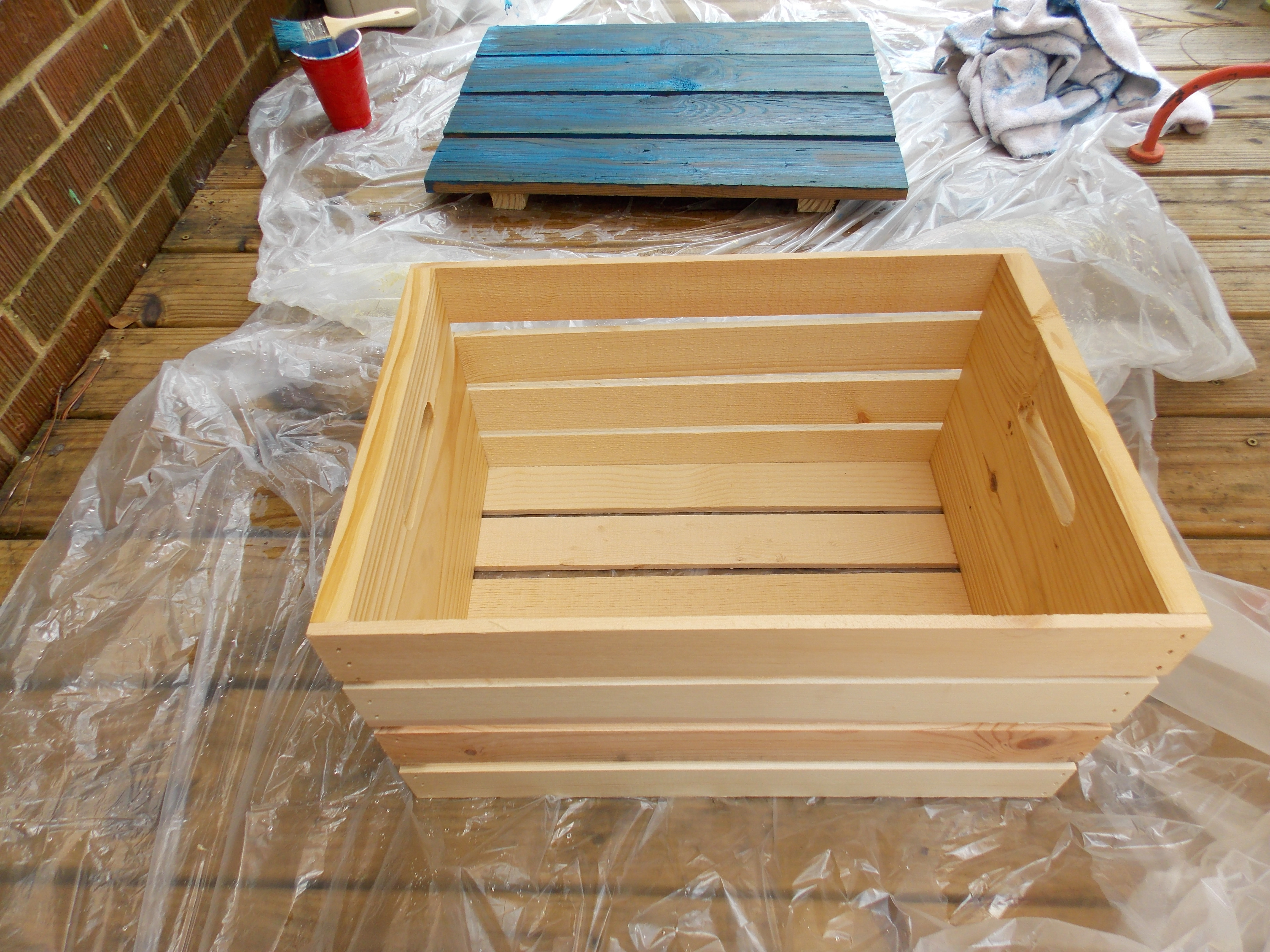 A little paint and water was all it took to transform this $10 crate proving you really can whitewash wood any color