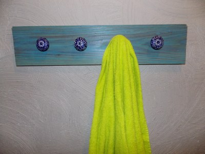 I whitewashed the wood on this simple towel rack for my bathroom.