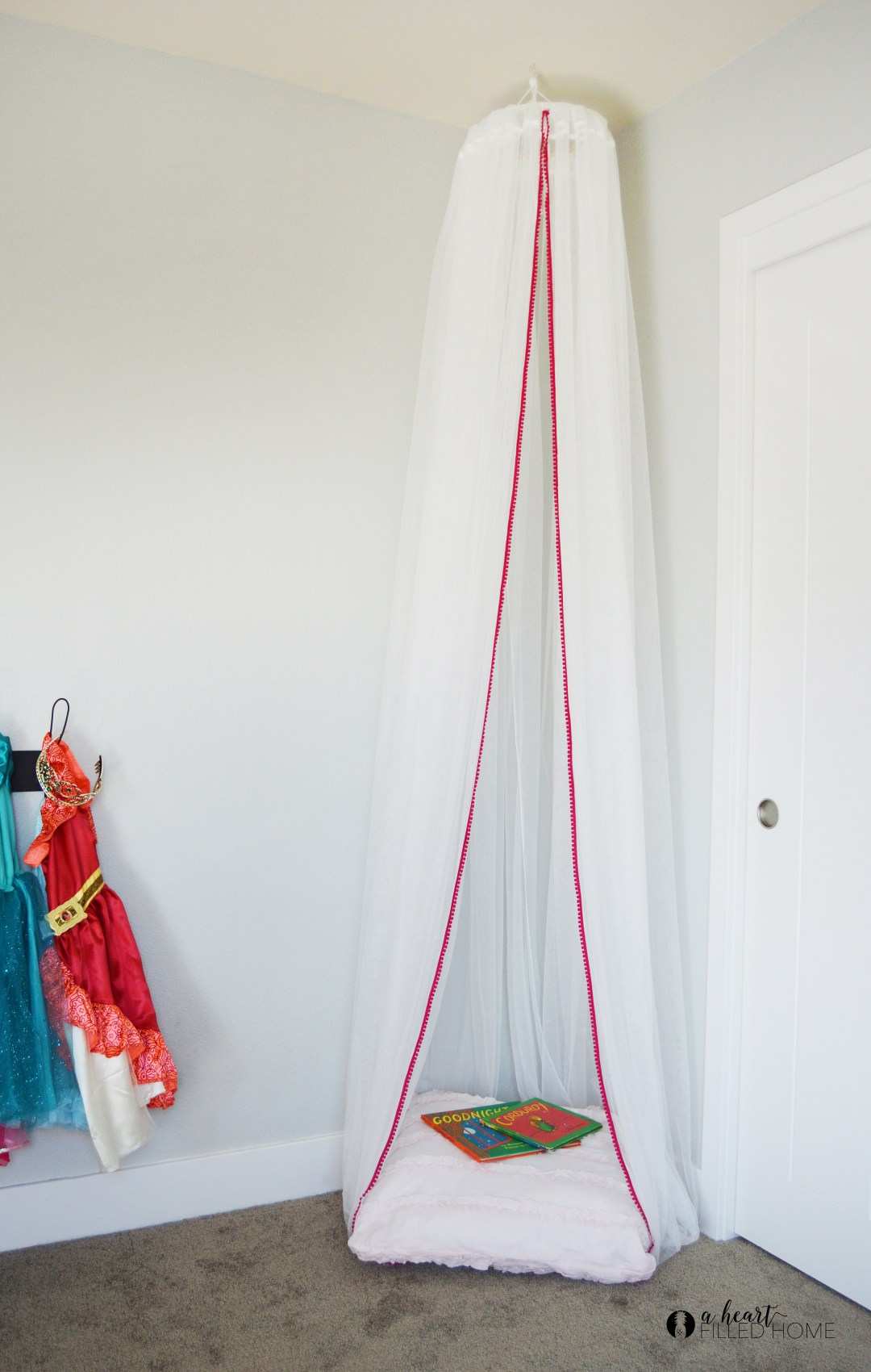How to make an easy DIY canopy! Visit aheartfilledhome.com for the simple DIY tutorial!