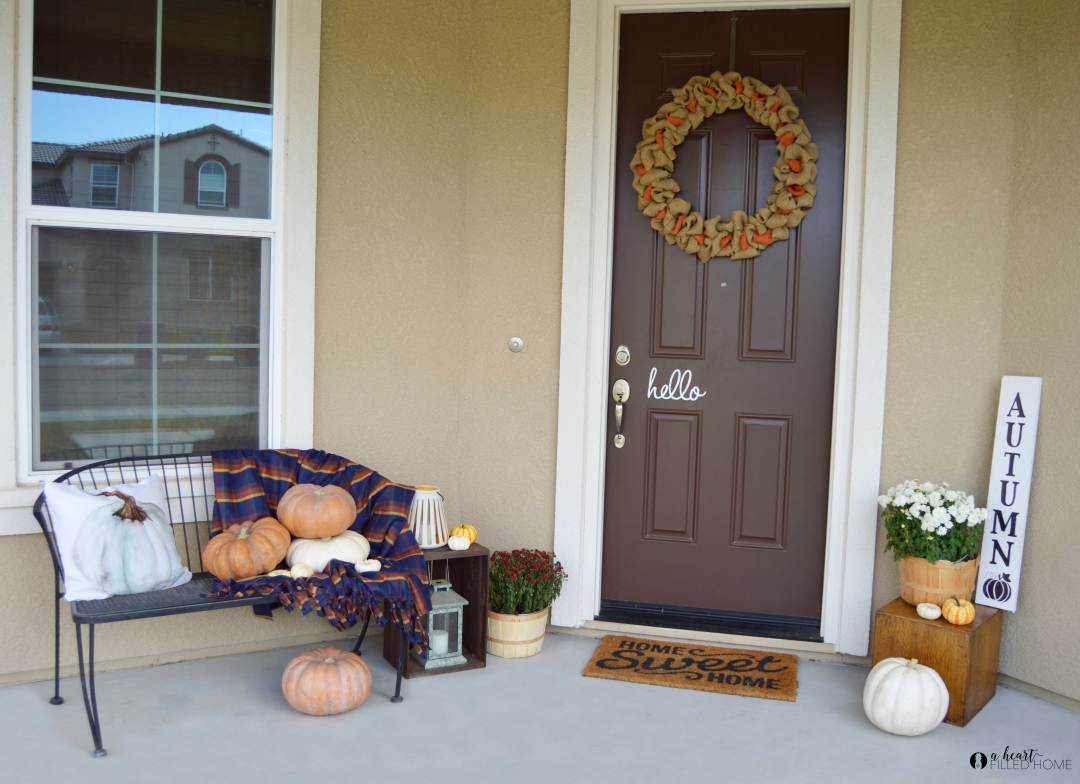 A Welcoming Fall Porch + 5 Fall Porch Decorating Tips! visit aheartfilledhome.com