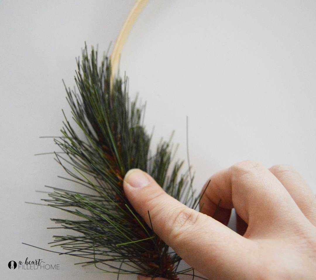 This DIY Winter Hoop Wreath is so easy to make! aheartfilledhome.com