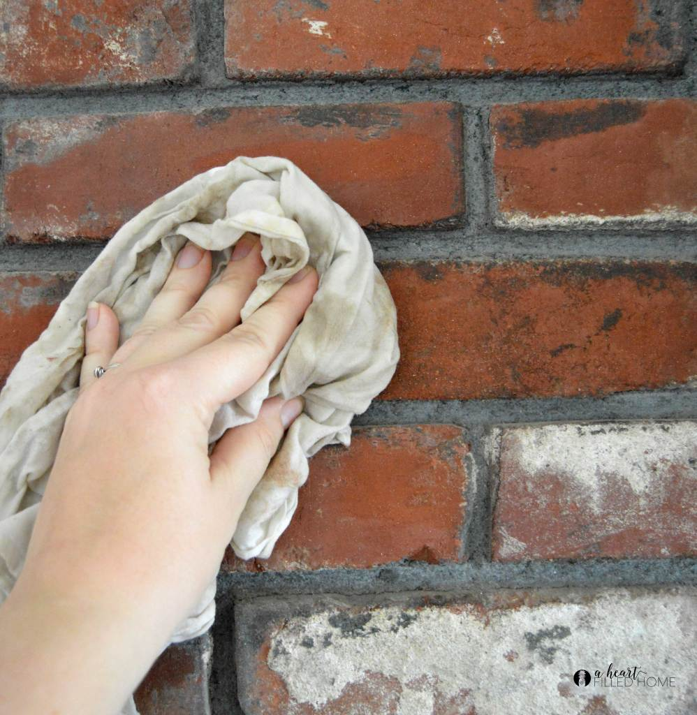 How to transform your old fireplace with lime wash! It is such an easy way to update your fireplace to look new and modern!