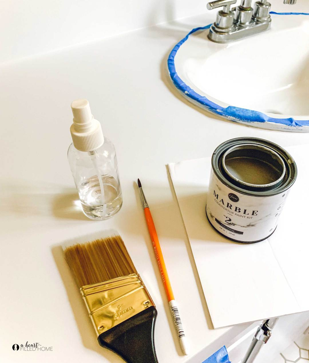 How to make your countertops look like marble! Are you stuck with ugly counters but can't afford to install marble? This marble paint kit can transform your countertop to look just like marble on a budget! from aheartfilledhome.com