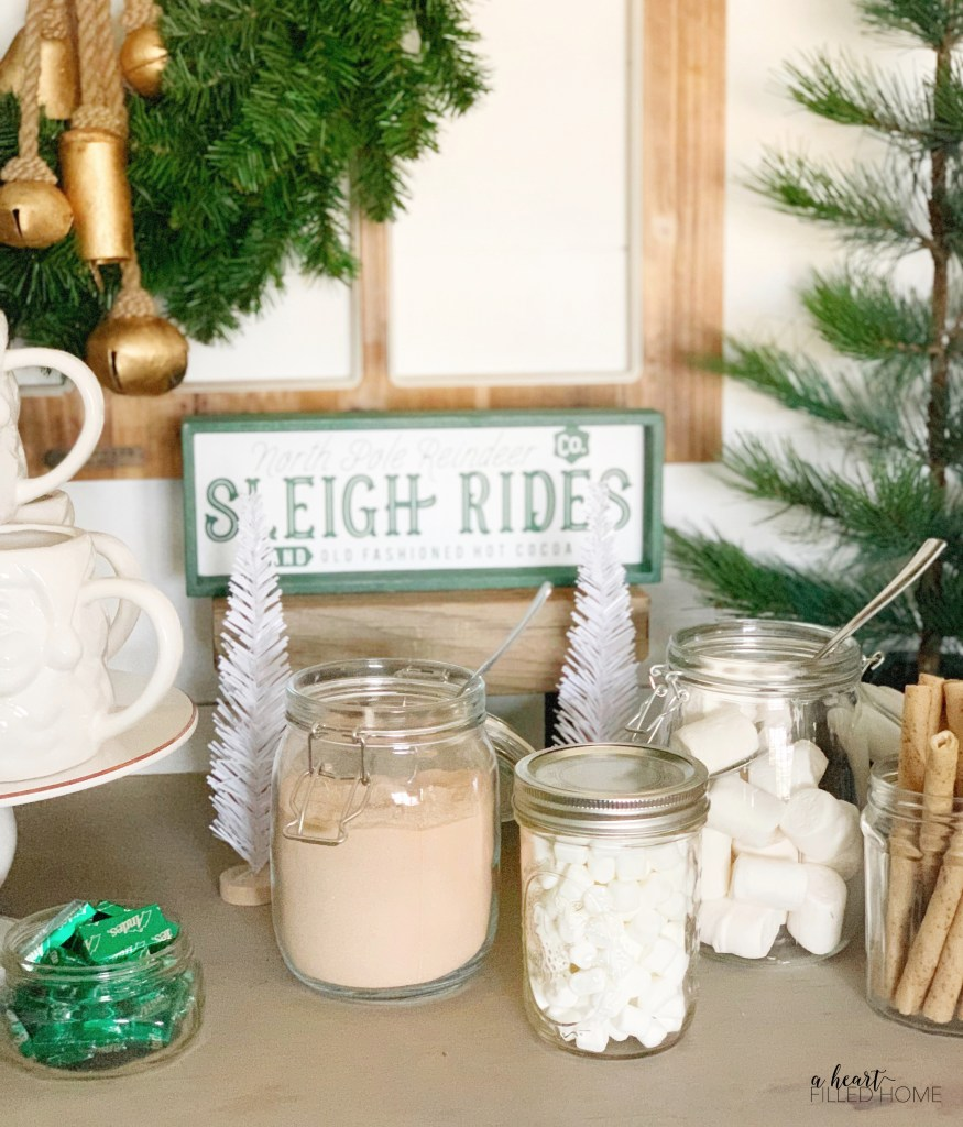 Learn how to create this easy DIY hot cocoa bar for your next holiday party, Christmas party, or winter birthday party! from A Heart Filled Home