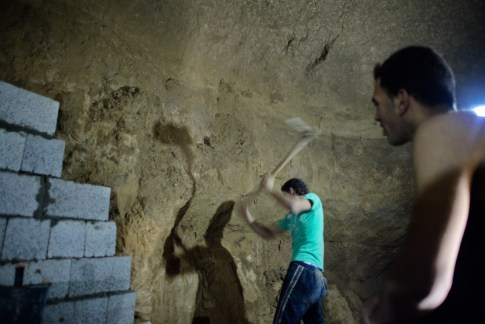 A Palestinian tunnel smuggler works inside a smuggling tunnel dug beneath the Gaza-Egypt border in the southern Gaza Strip, during a military operation for the Egyptian army to destroy the smuggling tunnels in Gaza.