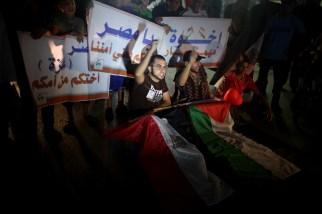 The Palestinian youth take part in rally in front of the headquarters of the Egyptian embassy in Gaza City to protest against closure Rafah crossing and destroy the tunnels and appeal Egypt government to open both of them.