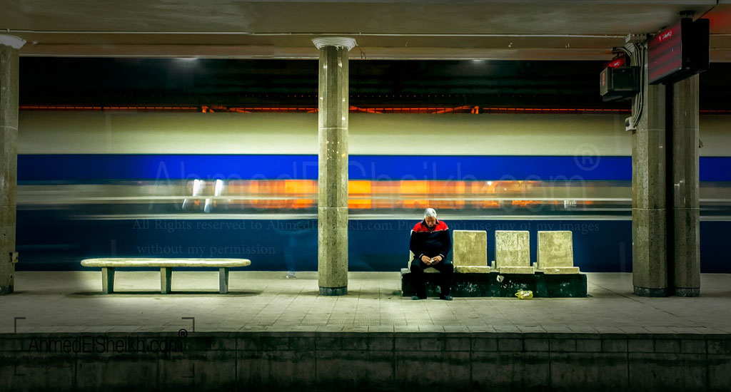Old man in train station