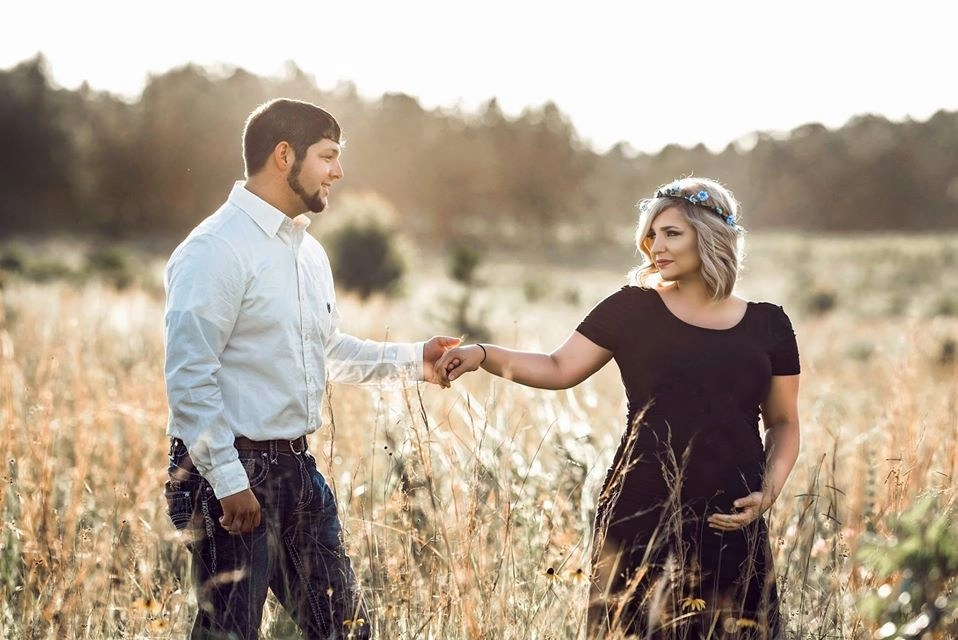 outdoor engagement photo session couple holding hands and looking into each other's eyes