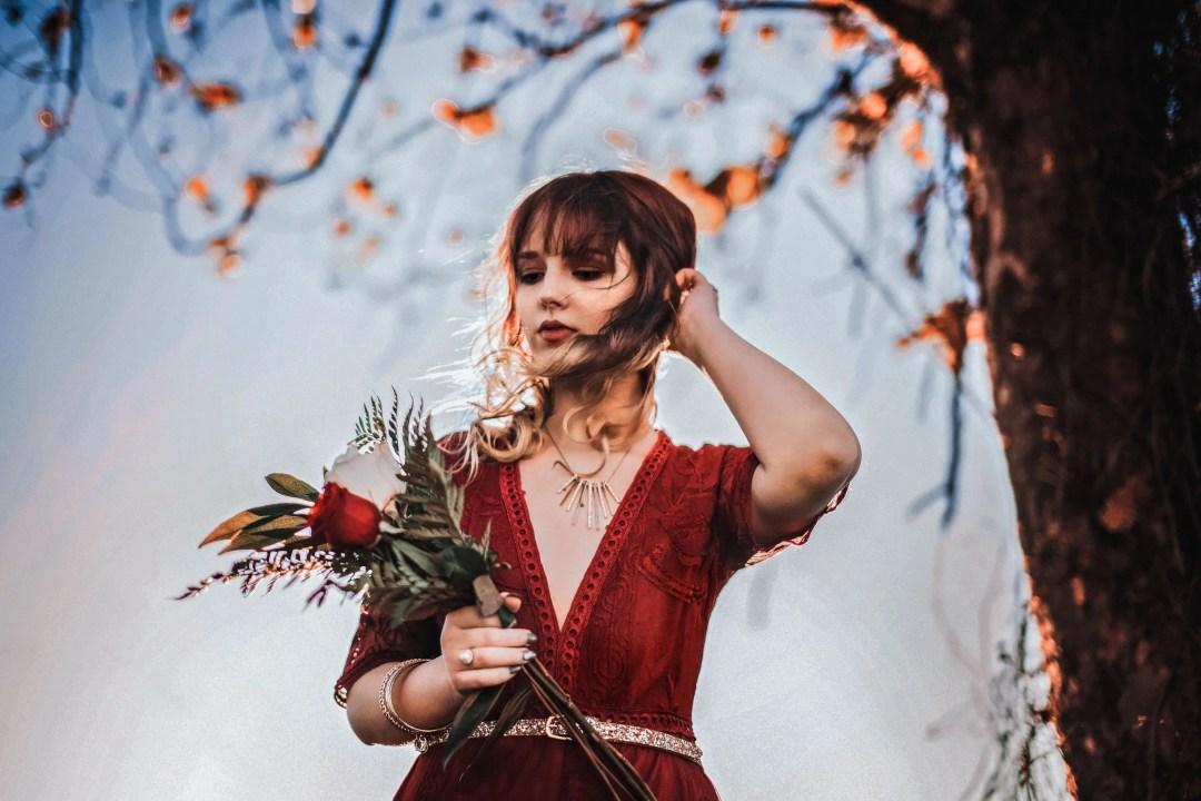 senior in red dress at buhlow lake in louisiana