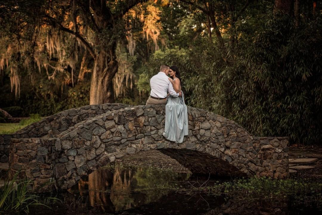 bride groom engagement photo shoot on bridge at jungle gardens avery island