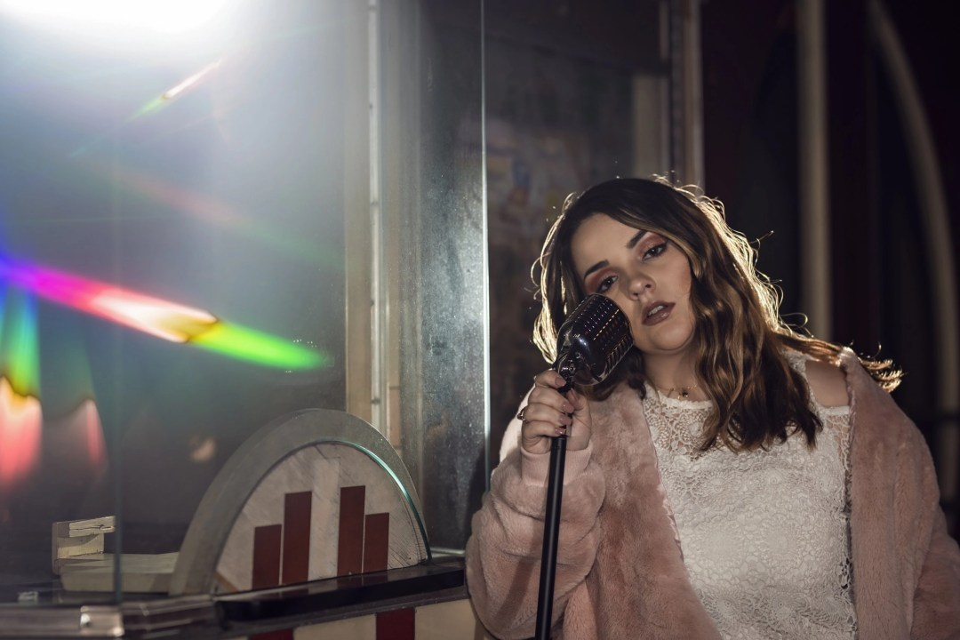 senior portrait singer with microphone