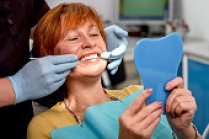 woman with dentist