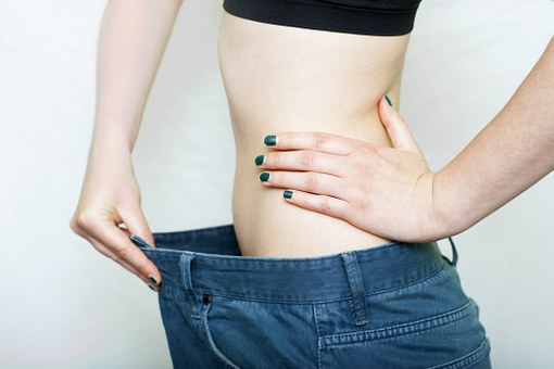 woman wearing bigger jeans