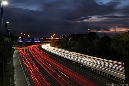 M60 at dusk with light trails