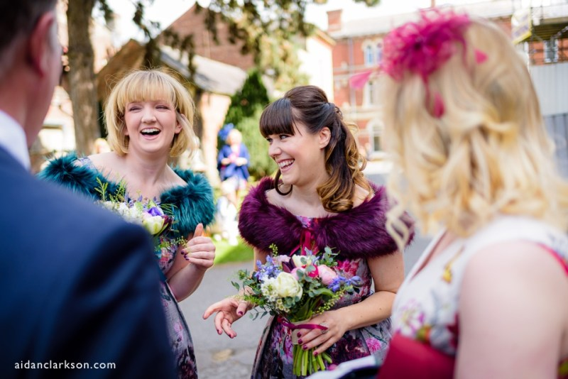 this is a photo of a bridesmaid laughing