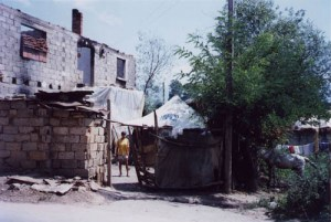 United Nations tent at burnt-out home in Kosova