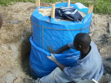 Making the concrete digester tank at Project Pierre Toussaint