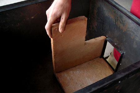Baldosa tile is cut and assembled to form the rocket combustion chamber
