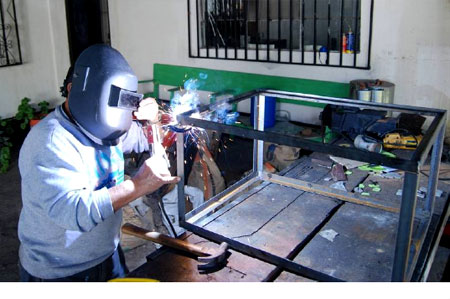 Don Prudencio Lopez fit and welded together the bracket pieces