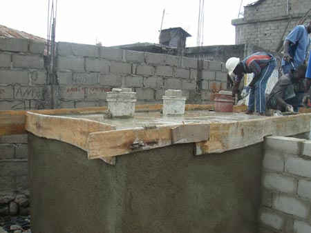 Molds for the toilet holes and pouring the concrete floor
