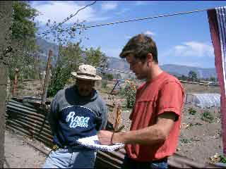 Maarten and Nedi Discussing Solar Hot Water Installation