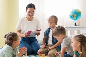 kindergarten-teacher-holding-notebook_23-2148633311