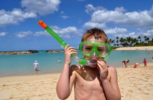 Boy with snorkeling mask, snorkel, in Hawaii