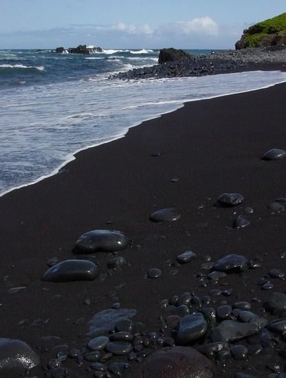 This is a black sand beach located close to Hana, Maui.