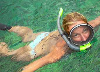 Girl snorkeling in Pacific Ocean, Maui, Hawaii