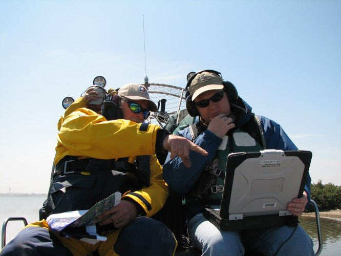 John and Chris consult about a field sample point on the PC / photo: Mark Finkbeiner