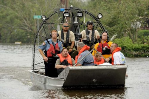 Rescue workers in an airboat evacuate local citizens from their flooded homes in the bayfront area of Galveston, Texas, USA, 13 September, 2008 following the landfall of Hurricane Ike. Galveston took a direct hit from Ike, which caused extensive flooding in the area. photo: EPA/Bob Pearson