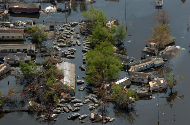 Aerial view of flood waters covering a roadway in New Orleans where people are launching rescue boats. New Orleans is being evacuated as a result of floods caused by hurricane Katrina. photo: DoD