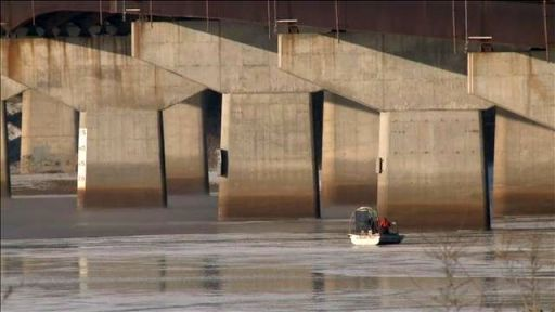 airboat searching for body under I-94 bridge