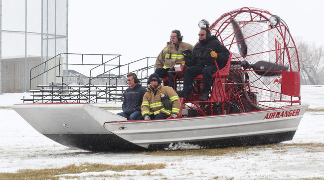 High River fire fighters try out their new Air Ranger behind Highwood High School during the Flood Preparedness Expo. It's another tool in their tool box for rescues, according to Len Zebedee, fire chief.