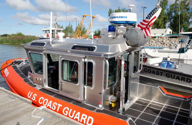 Rescue boats are docked at the Coast Guard Station Saginaw River in Essexville in this file photo.The Coast Guard used a 24-foot airboat on Sunday, June 1, to rescue four boaters from Saginaw Bay after their vessel capsized.