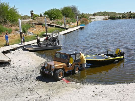 A U.S. Fish and Wildlife vehicle uses the restored launch ramp in Varner Harbor, March 24, 2016.