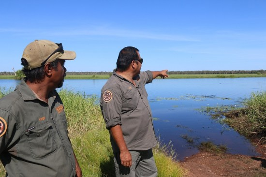 Rangers Fred Hunter and Calvin Murakami survey the Magela floodplain.