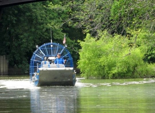 Mike Gasdorf entertains passengers last summer with a history of Fort Wayne's majestic rivers before beginning his airboat tour through the waterways.